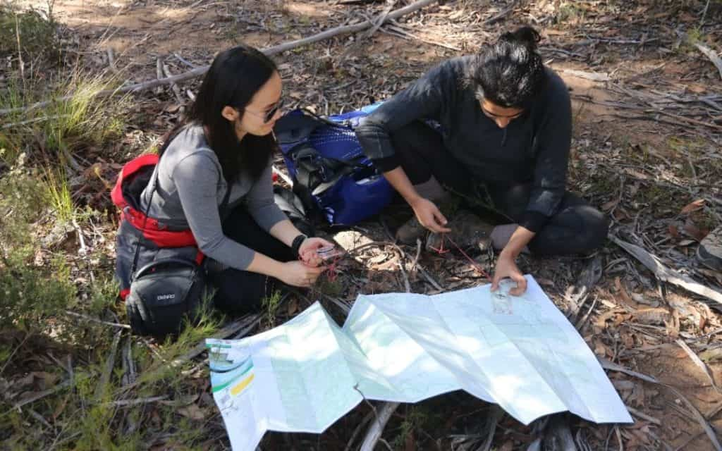 Bush walkers reading a map